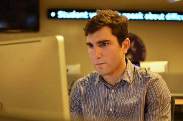 Jordan Rubio writes a story at TCU. Photo by:  Michael Macias-Martinez