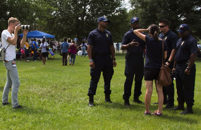 "Jon LaFlamme photographs Baton Rouge police officers during the annual ""Pack the Park"" event in Baton Rouge, Louisiana.Photo by: Claudia Balthazar"