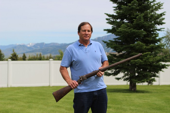 Bill Goodman, an antique firearms dealer, holds a .45-caliber buffalo gun in his backyard in Bozeman, Mont. Jessica Boehm