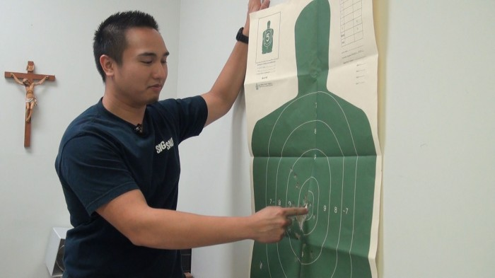 Music Minister Mathew Maglasang shows the target he used in his concealed carry test.  Sydney Stavinoha